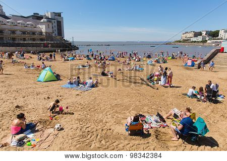 Marine lake beach Weston-super-Mare Somerset with tourists and visitors enjoying the August sunshine
