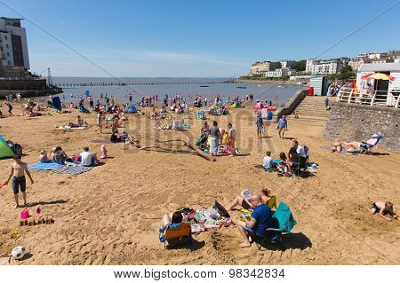 Marine lake beach Weston-super-Mare Somerset with tourists and visitors enjoying the August sun