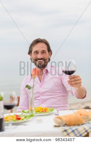 Handsome man drinking wine