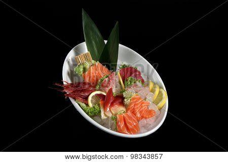 Round Plate Of Sushi And Sashimi On Black