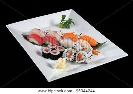Various Sushi And Sashimi On White Plate