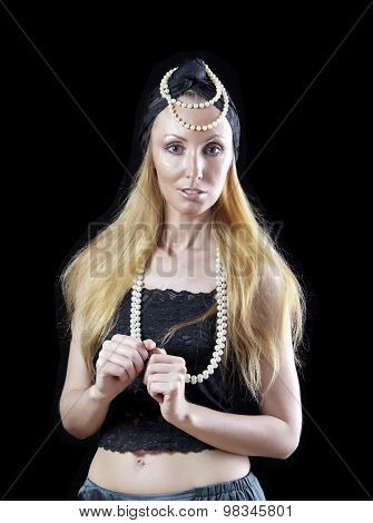 The beautiful blonde woman with long hair with a pearl beads