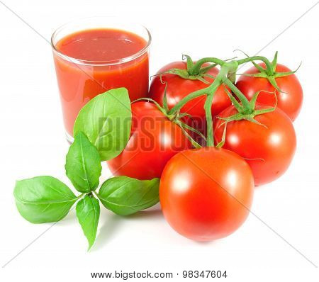 Bunch of fresh tomatoes with basil leaves and glass of tomato juice isolated on white