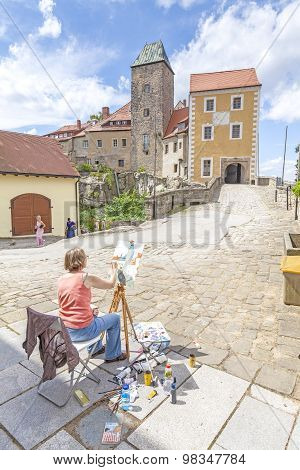 Hohnstein, Germany - July 25, 2015: Woman Painting Hohnstein Castle, One Of The Top Tourist Attracti
