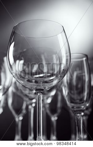 Empty wine glasses on gray background