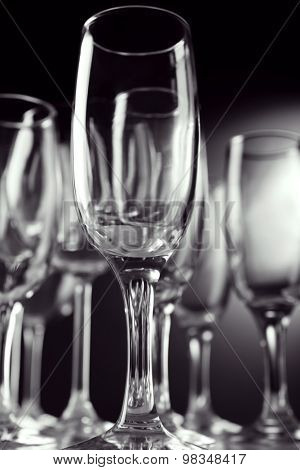 Empty champagne glasses on gray background