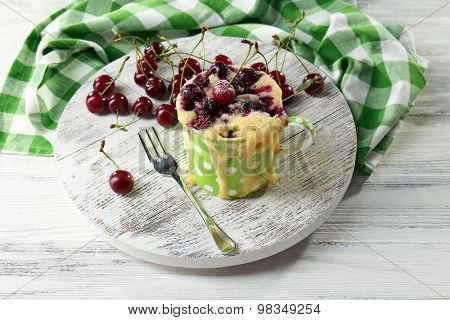 Tasty pudding with cherries on table close up