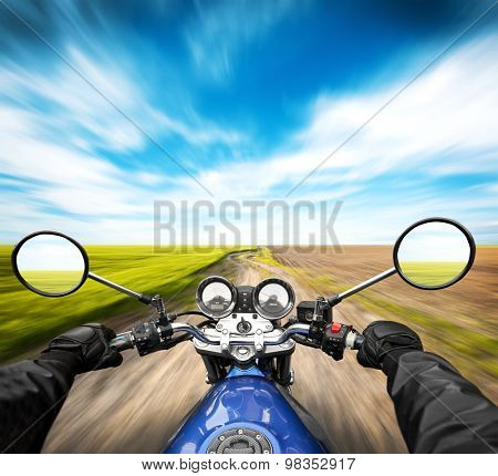 Man driving on moto on big speed on country road