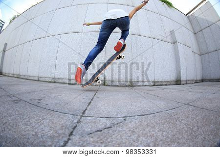 closeup of young skateboarder skateboarding at city