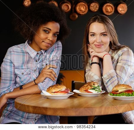 Cheerful multiracial girls in a cafe