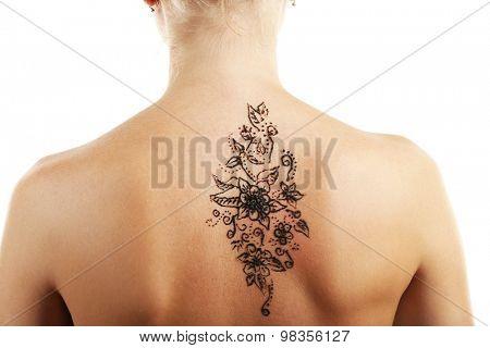 Back painted with henna- Mehendi, isolated on white