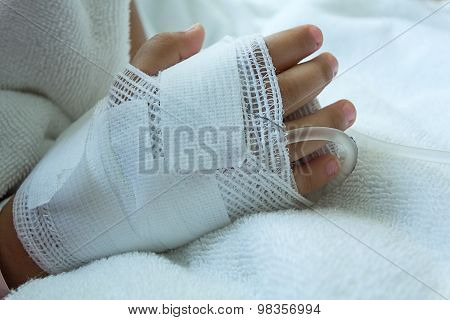 Hand illness asian kids a sickbed, saline intravenous (IV) on hand