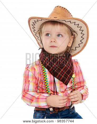 little girl in a cowboy outfit