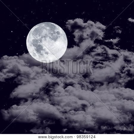 Full moon on the cloudy sky
