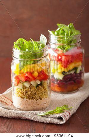 vegan quinoa vegetable salad in mason jars