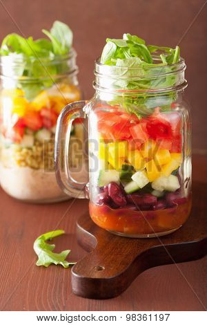 vegan bean vegetable salad in mason jars