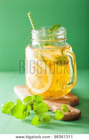 ice tea with lemon and melissa in mason jar