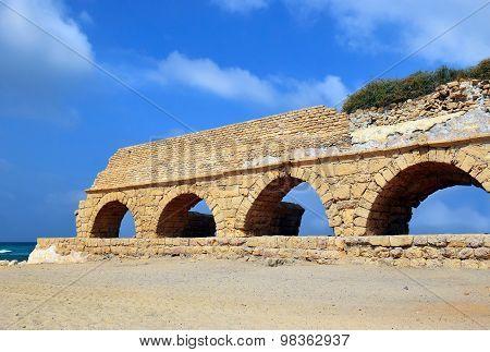 Ancient Roman Aqueduct At Ceasarea, Israel