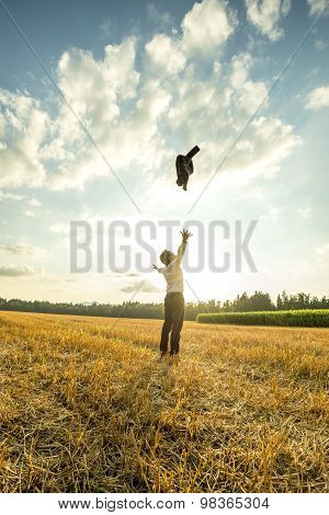 Businessman Throwing Coat In The Air At The Field