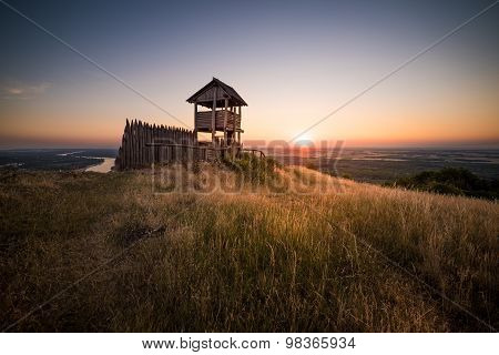 Wooden Tourist Observation Tower Over A Landscape At Beautiful Sunset
