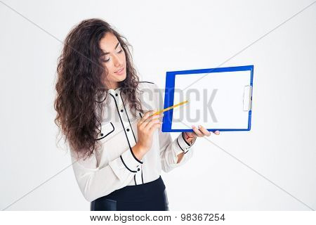 Young businesswoman presenting something on clipboard isolated on a white background