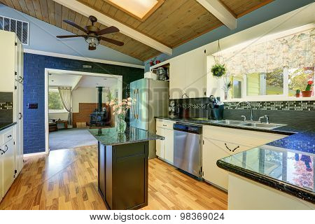 Modernized Kitchen With Blue Walls.