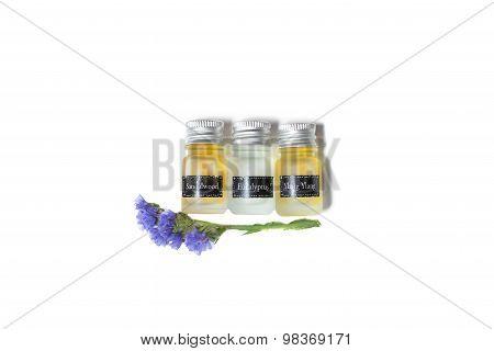 Bottles of organic oils and flowers