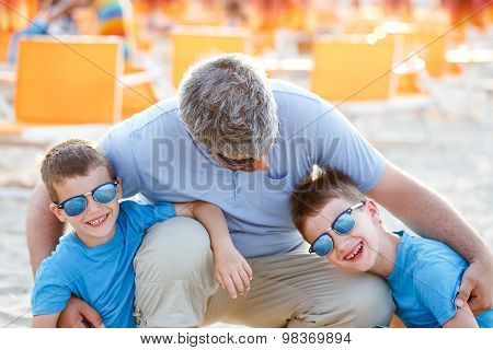 Father Embracing Sons Outdoor