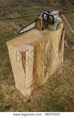 Chainsaw And A Block Of Wood