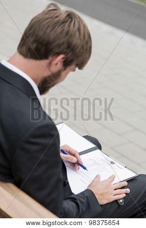 Sitting At Paper Work