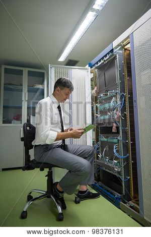 network engineer working in  server room, corporate business man working on tablet computer