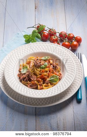 tagliolini with squid and fresh tomatoes