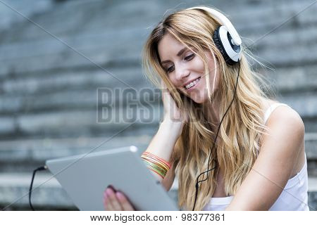 Blonde Watching Something On Tablet