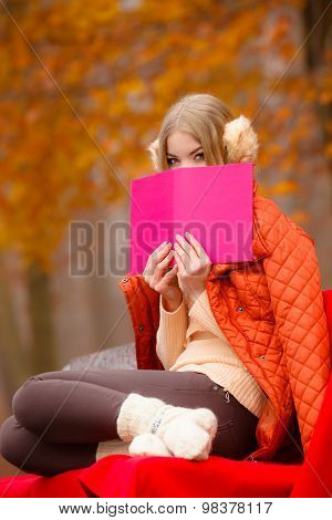 Girl Relaxing In Autumn Park Reading Book
