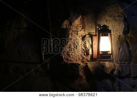 Wall lantern in a dark cave