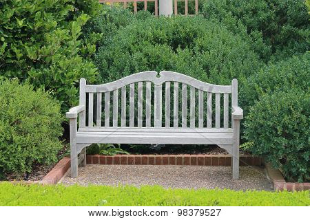 Bench surrounded by shrubbery