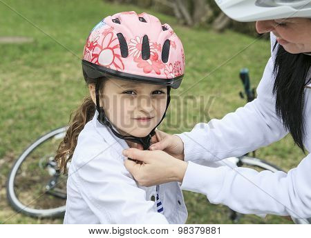 Beautiful and happy young on bicycle with her daughter.