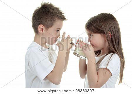 Child drinking milk on white background
