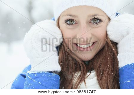 A woman portrait outside in winter season