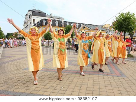 FRANTISKOVY LAZNE CZECH REPUBLIC - AUGUST 9 , 2015: Unidentified happy patients marching on street. City with mineral springs that attract many people wishing to improve their health and body mass.