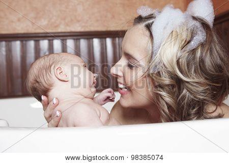 A little baby girl taking a bath