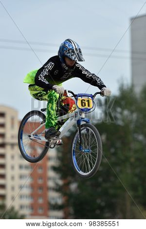 ST. PETERSBURG, RUSSIA - AUGUST 6, 2015: Unidentified biker in the BMX race Cruiser. The competitions is a stage of the BMX racing championship of Russia