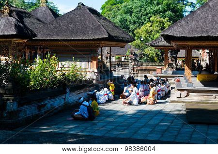People praying in Turta Empul temple in Bali, Indonesia.