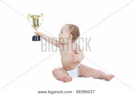baby holding gold trophy cup on a white background