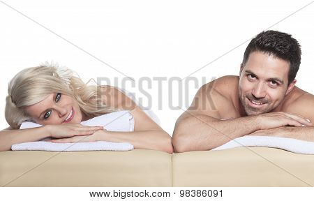 adults receiving massage in studio white background