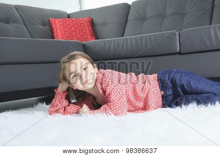 8 years old child laying down at home alone
