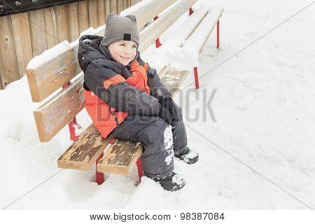Winter bench boy