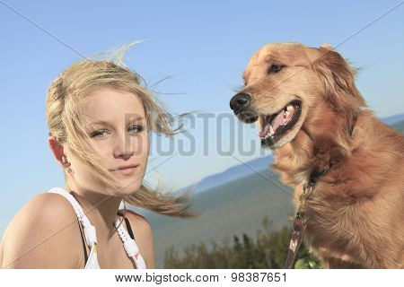 girl plays with the dog outside