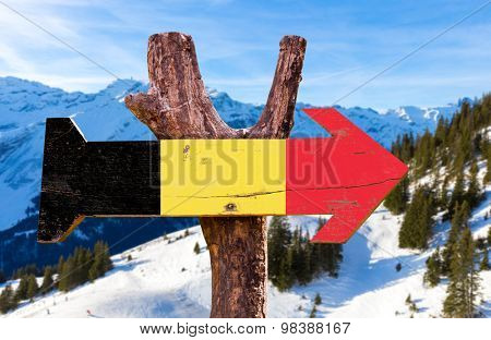 Belgium Flag wooden sign with winter background