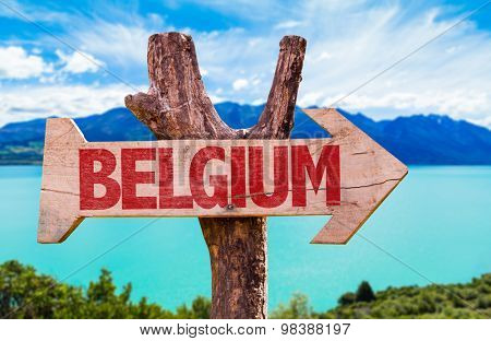 Belgium wooden sign with river on background